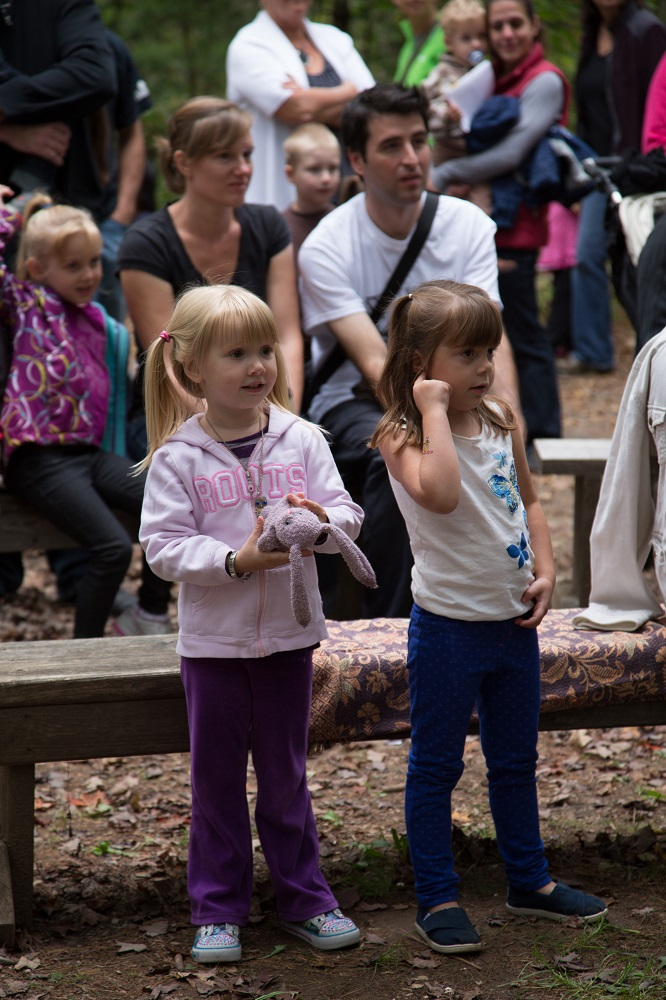 Little girls standing in the audience at the Telling Tales Festival