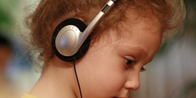 Young girl listening to headphones