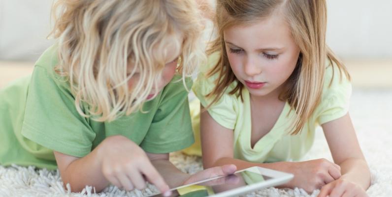 Little girls using a tablet