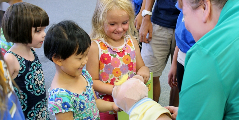 Group of children interacting with a puppet