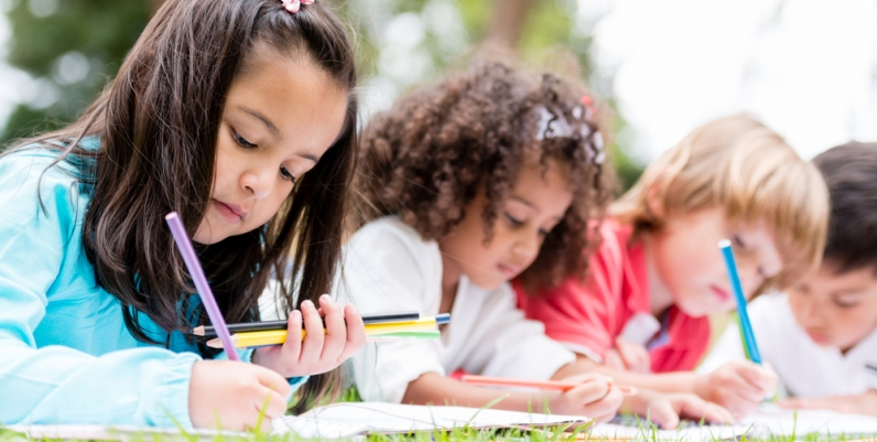 Group of children coloring at a park