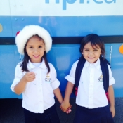 Photo of two little girls standing in front of the HPL Bookmobile