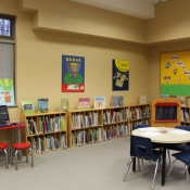 Looking into the childrens area of the Freelton Library, with book shelves along the wall