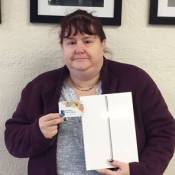 woman holding ipad and library card