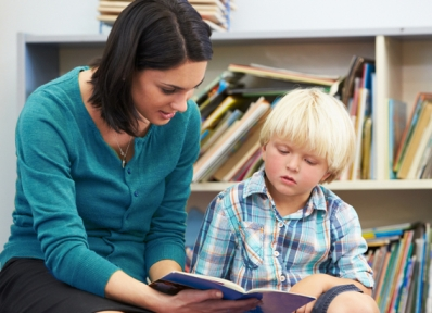 Woman reading with a young boy