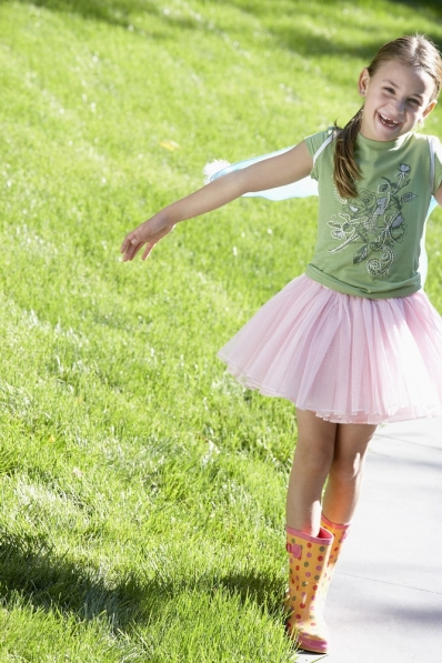 Little girl in pink tutu outdoors