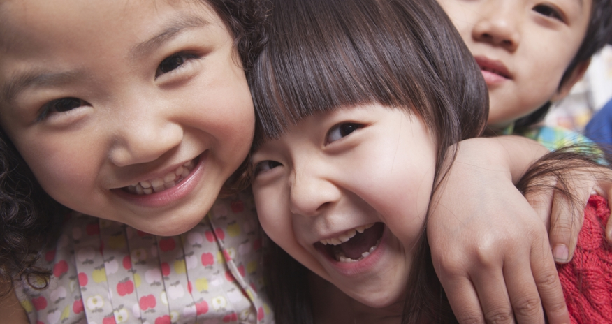 Closeup of young children laughing
