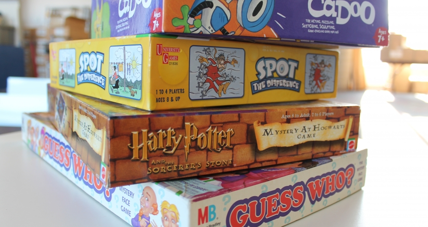 A stack of children's board game boxes