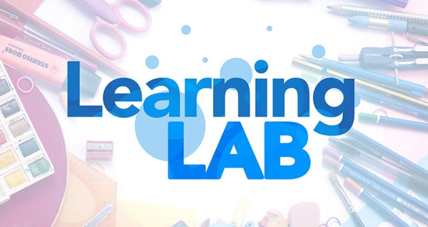 Text of Learning Lab with various school supplies in the background