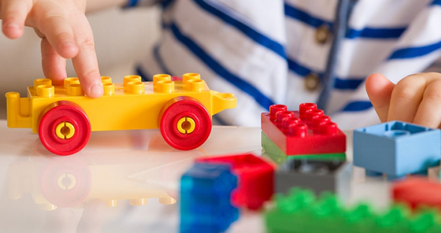 child playing with LEGO