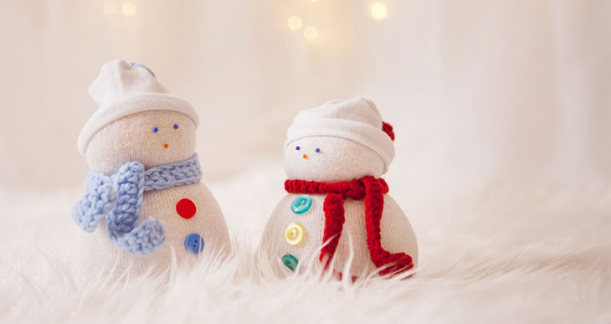 photo of snowmen made out of socks
