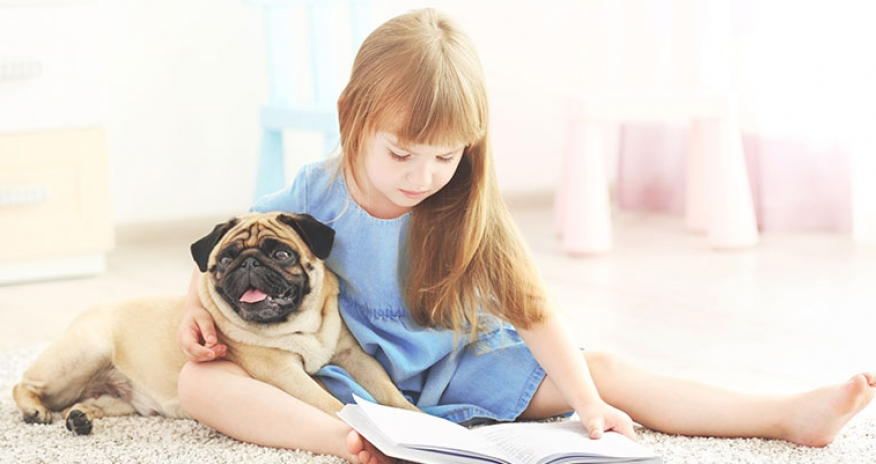 girl reading with a dog
